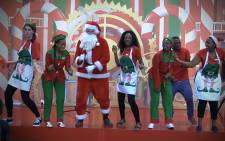Santa Claus and his helpers having a good time at Menlyn Mall. Picture: Kgothatso Mogale/EWN