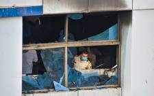 This archive picture shows a policeman inspecting a burnt-out room at the Vijay Vallabh Hospital in Virar, on the outskirts of Mumbai, on April 23, 2021. Picture: AFP.