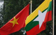 The Myanmar national flag flies next to the Vietnamese national flag. Picture: AFP/POOL/HOANG DINH Nam