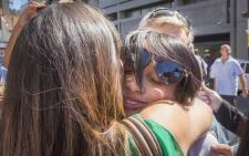 Celeste Nurse embraces friends and family after the woman who kidnapped her biological daughter Zephany was found guilty on 10 March 2016. Picture: Aletta Harrison/EWN