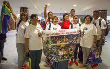 Wayde van Niekerk's family members pose for photographs upon their arrival at Cape Town International Airport on 18 August 2016. Picture: Aletta Harrison/EWN