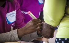 FILE: IEC officials process voters at a school in Matsila. Picture: Thomas Holder/EWN.