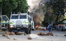 A police nyala stands in the streets of Pretoria littered with rocks during student protests on 23 October 2015. Picture: Reinart Toerien/EWN.