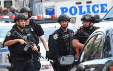 Police talk outside the Bronx-Lebanon Hospital as they respond to an active shooter north of Manhattan in New York on 30 June 2017. Picture: AFP.