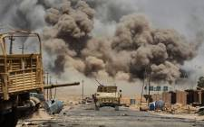 Smoke billows as Iraqi forces advance towards Al-Ayadieh village, the last remaining active front line near Tal Afar, during an operation to retake the city from the Islamic State (IS) group on August 29, 2017. Picture: AFP.