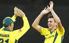 Australia's Jhye Richardson (right) celebrates with teammate David Warner after taking the wicket of England's Jonny Bairstow during the one-day international cricket match between England and Australia in Brisbane on 19 January 2018. Picture: AFP.