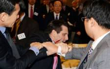US ambassador to South Korea, Mark Lippert (C) with a wound on his face as he leaves the Sejong Cultural Institute in Seoul, after being injured in an attack by an armed assailant. Picture: AFP