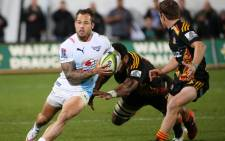 """Francois Hougaard (left) of the Northern Bulls looks to step past Waikato Chiefs' Brad Weber (right) during a Super 15 rugby match in Rotorua on May 22, 2015. Picture: AFP."""""""