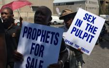Members of 'False Prophets Must Fall' group marching in Braamfontein against the abuse of women and children under the guise of religion. Picture: Katleho Sekhotho/EWN.