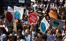 Students from different schools raise placards during a protest rally for climate change awareness at Martin Place in Sydney on 30 November 2018. Picture: AFP