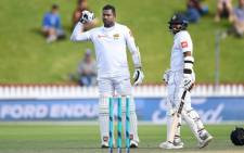 Sri Lanka's Angelo Mathews celebrates scoring a century with Kusal Mendis during the first Test against New Zealand on 18 December 2018. Picture: @BLACKCAPS/Twitter