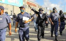 Police Minister Bheki Cele visited the Bellville taxi rank on 10 December 2020 as part of a Safer Festive Season inspection tour in the Western Cape. Picture: @SAPoliceService/Twitter