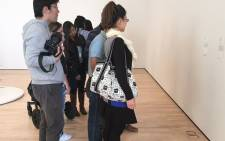Prankster puts glasses on the floor as art at San Francisco Museum of Modern Art. Picture: Twitter @TJCruda.