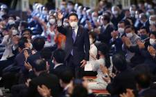 Candidate for the presidential election of the ruling Liberal Democratic Party (LDP) Fumio Kishida (C), former foreign minister, reacts after being elected as the new president at the LDP presidential election in Tokyo on September 29, 2021. Picture: AFP.