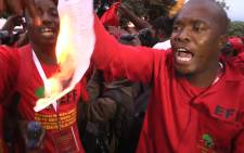 EFF members burn a list they allege was used to predetermine the nominations for the party's Central Command Team. Picture: Vumani Mkhize/EWN.