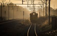 A train approaches Mutual Station in Cape Town at dawn. Picture: Aletta Harrison/EWN.