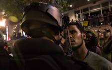 A protester stares at riot police during a demonstration against police brutality in Charlotte, North Carolina, on 21 September, 2016, following the shooting of Keith Lamont Scott the previous day. Picture: AFP.