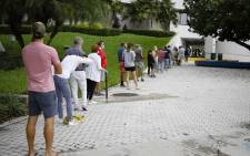 In this photo taken on 19 October 2020, voters wait in line to cast their early ballots at Miami Beach, Florida, City Hall. Picture: AFP