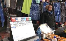 A woman pictured at a stall near the Khayelitsha Taxi Rank. Picture: Kaylynn Palm/EWN