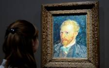 """FILE: A visitor looks at a self-portrait by late Dutch painter Vincent Van Gogh displayed at the Orsay Museum in Paris. Picture:AFP."""""""