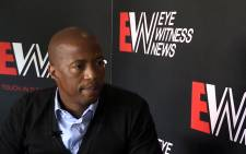 Former South African football player Jimmy Tau is interviewed by EWN's Sheldon Morais on his thoughts of the Fifa World Cup. Picture: Reinart Toerien/EWN