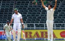 Indian bowler Zaheer Khan (R) celebrates after bowling out South African batsman on the 5th day of a first cricket Test match between South Africa and India in Johannesburg at Wanderers Stadium on December 22, 2013. Picture: AFP.