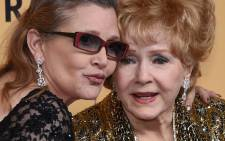 Actress Carrie Fisher (left) with her mother Debbie Reynolds. Picture: AFP
