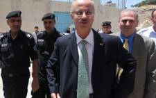 Newly appointed Palestinian Prime Minister, Rami Hamdallah, arrives for a visit to the West Bank city of Nablus on 4 June 2013. Picture: AFP