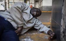 FILE: An injured man pictured during violent protests in Zimbabwe. Thomas Holder/EWN.