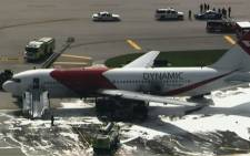 A screengrab shows an engine on a passenger jet bound for Caracas, Venezuela, burst into flames while taxiing for takeoff at a Florida airport on 29 October, forcing frightened passengers to exit the plane using inflatable emergency slides.