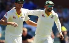 Josh Hazelwood celebrates a wicket with teammate Nathan Lyon. Picture: Twitter/@CricketAus