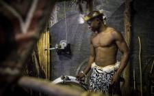 A drummer from Lesedi Cultural Village plays during a dance performance. Picture: Thomas Holder/EWN
