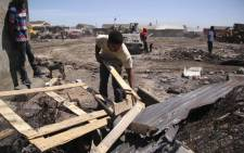 Residents from 7de Laan informal settlement clean the area after a shack fire. Over 300 people were displaced after a fire tore through the informal settlement on Boxing Day. Picture: Cindy Archillies/EWN.