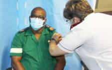 Paramedic Cedric Yantolo gets vaccinated at the George Hospital vaccination site Image: Premier Alan Winde/Facebook