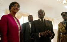 UN High Commissioner for Human Rights Navi Pillay (L) poses with Zimbabwe Presidebt Robert Mugabe (2nd R) on May 23, 2012 at the State House in Harare. Picture: AFP