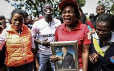 Supporters of Prophet Shepherd Bushiri protest outside the Specialised Commercial Crimes Court in Pretoria. Bushiri and his wife Mary appeared in court for charges of fraud, money laundering and contravening the Prevention of Organised Crimes Act. Picture: Abigail Javier/EWN.