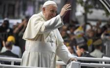 Pope Francis waves at the faithful from the Popemobile in Santiago. Pope Francis is visiting Chile from 15 to 18 January, before heading to Peru from 18 to 21 January.