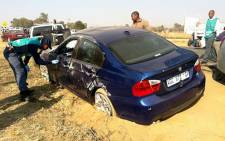 The blue BMW which suspects feld and crashed in after the shooting in Fourways. Picture: Alex Eliseev/EWN