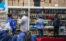 Customers visit the camping section at Makro Woodmead to purchase camping lighting to tackle the darkness of load shedding. Picture: Thomas Holder/EWN