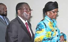 President of Zimbabwe Robert Mugabe and his wife Grace in Italy in 2011. Picture: EPA.