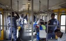 Police accompany commuters during a trip from the Naledi station in Johannesburg on 28 May 2018. Picture: Thomas Holder/EWN.