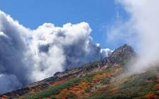 This picture taken by climber Keiji Aoki on September 27, 2014 shows white smoke raising from Mount Ontake as Japan's volcano Ontake erupted in Nagano prefecture, central Japan. Picture: AFP/ JIJI PRESS/KEIJI AOKI JAPAN OUT