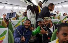 Passengers pose for a selfie picture inside an Ethiopian Airlines flight which departed from the Bole International Airport in Addis Ababa, Ethiopia, to Eritrea's capital Asmara on 18 July 2018. Picture: AFP.