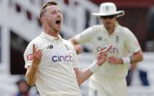 England's Ollie Robinson celebrates taking the wicket of New Zealand's Ross Taylor out for 14 runs on the first day of the first Test cricket match between England and New Zealand at Lord's Cricket Ground in London on 2 June 2021. Picture: Adrian Dennis/AFP