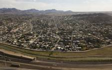 An aerial picture taken on 24 June 2021 shows the Rio Grande river and border wall fencing at the US-Mexico border separating El Paso and the Mexican city of Ciudad Juarez, Chihuahua state, Mexico, in El Paso, Texas. Picture: Patrick T. FALLON/AFP