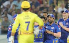 Mumbai Indians players celebrate a wicket against Chennai Super Kings during their nail-biting Indian Premier League final on Sunday. Picture: @mumbaiindians/Facebook.com.