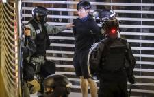FILE: Riot police arrest a protester inside the City Plaza mall in the Tai Koo Shing area in Hong Kong on 3 November 2019. Picture: AFP