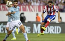 Atletico Madrid's midfielder Raul Garcia kicks the ball during the Spanish league football match Club Atletico de Madrid vs S.D Eibar at the Vicente Calderon stadium in Madrid on 30 August, 2014. Picture: AFP.