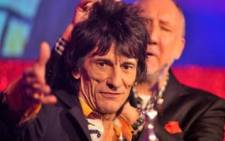 Ronnie Wood from the rock group the Rolling Stones with his Outstanding Contribution award onstage with Pete Townshend. Picture: Getty Images.