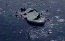 FILE: An inflatable boat capsizes in the Mediterranean Sea, killing forty migrants. Fifty-five were rescued. Picture: CNN.